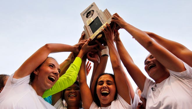 Logan players hoist the trophy after winning the 3A girls high school soccer championship at Rio Tinto Stadium on Saturday.