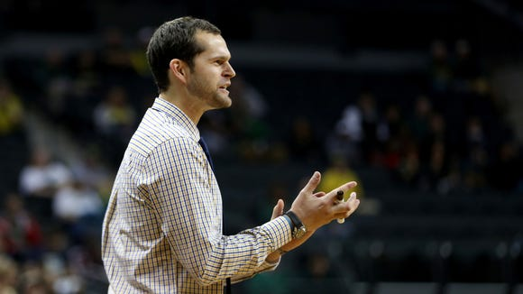 Northwest Christian Head Coach Luke Jackson calls to his team in the Northwest Christian vs. Oregon men's exhibition basketball game at the Matthew Knight Arena in Eugene on Tuesday, Nov. 3, 2015. The Ducks won the game 92-44.