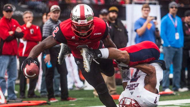 Western Kentucky wide receiver Taywan Taylor (2) reaches over the goal line for a touchdown while Florida Atlantic Owls defensive back Cre'von LeBlanc (7) attempts to tackle him  during an NCAA college football game, Saturday, Nov. 7, 2015, in Bowling Green, Ky.