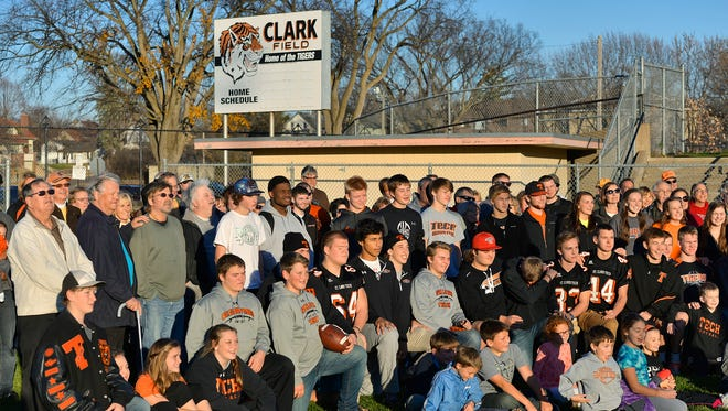 The Friends of Clark Field gather about 100 supporters for a photo Sunday afternoon to promote the restoration of the historic football field.