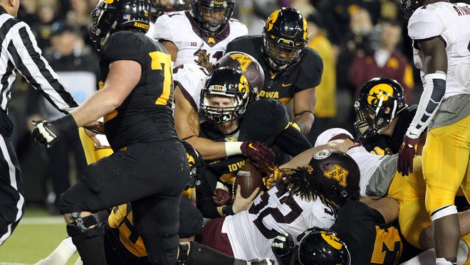 Iowa quarterback C.J. Beathard fights his way into the end zone during the Hawkeyes' game against Minnesota at Kinnick Stadium on Saturday.