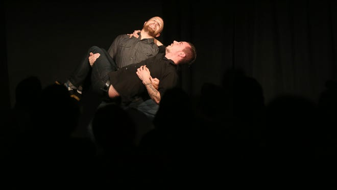 Jared Richard carries Reverand Buerge during an improv comedy show at the Capitol City Theater.