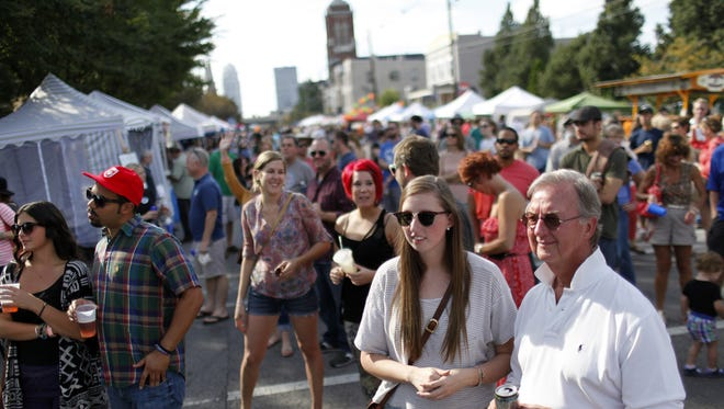 A crowd listens to live music at the 5th annual NuLu festival last September. The crowd listens to live music at the 5th annual NuLu festival in 2013.