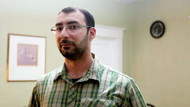 Ali Al Omrani, a Muslim refugee from Iraq and former interpreter with the United States Army, stands for a photo in his West Salem home on Tuesday, Dec. 8, 2015.