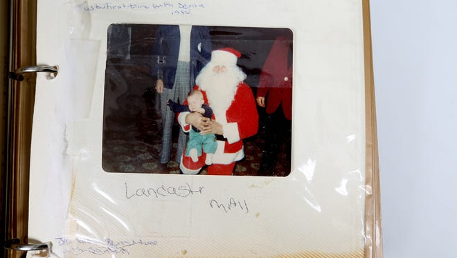 Terry Miller of Shaw has taken her family to be photographed with Santa Claus at Lancaster Mall for 35 years. This 1980 photo of son Justin with Santa started the tradition. This year, 21 Millers posed with Santa.
