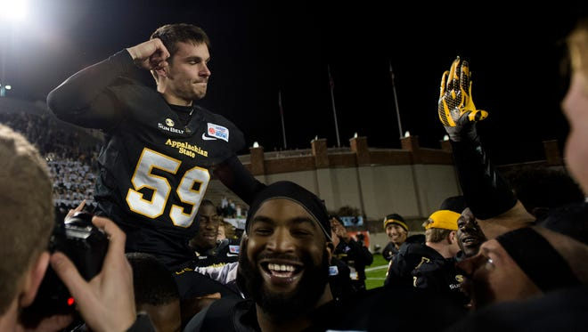 Appalachian State place kicker Zach Matics (59) is lifted into the air while celebrating after kicking the game winning field goal putting Appalachian State over Ohio 31-29 in the Camellia Bowl at Crampon Bowl in Montgomery, Ala., on Saturday, Dec. 19, 2015.Albert Cesare / Advertiser