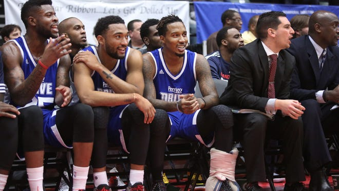 From left, the Pistons' Reggie Bullock, Darrun Hillard and Brandon Jennings watch the action from the bench during Grand Rapids' D-League game against Iowa on Saturday night.