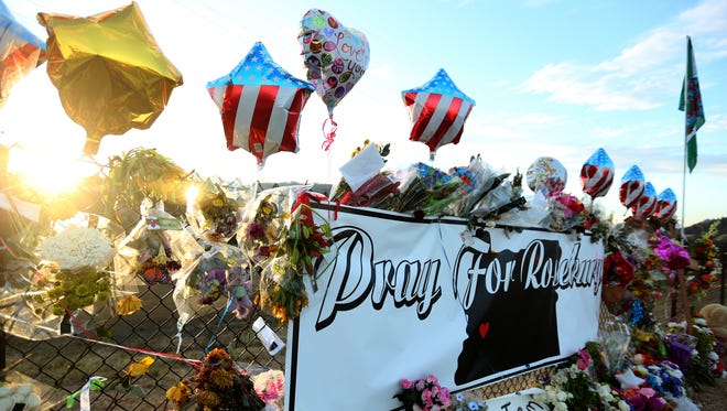 Flowers, letters and other items are left at a memorial at Umpqua Community College in Roseburg, Ore., on Friday, Oct. 9, 2015. Ten people, including the gunman, were killed and nine others injured in a mass shooting at UCC on Oct. 1.