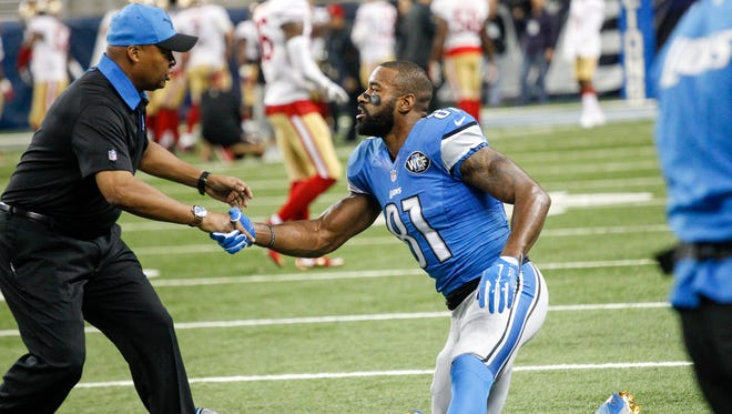 Detroit Lions Head Coach Jim Caldwell shakes hands with WR Calvin Johnson before the start of the NFL game against the San Francisco 49ers at Ford Field in Detroit on Sunday, Dec. 27, 2015.