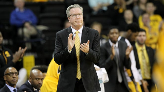 Iowa head coach Fran McCaffery glances at the scoreboard during the Hawkeyes' victory over Michigan State at Carver-Hawkeye Arena on Tuesday, Dec. 29, 2015.