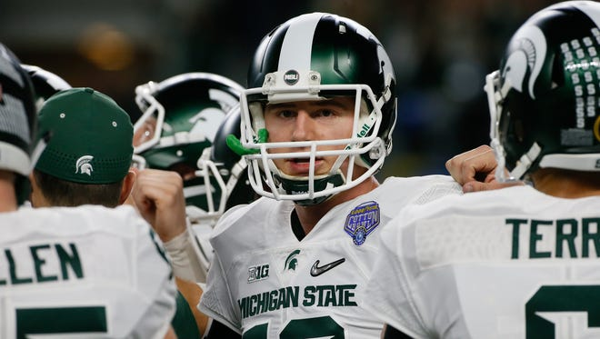 Michigan State quarterback Connor Cook before warms up before the start of the Goodyear Cotton Bowl Classic in Arlington, Texas on Thursday, Dec. 31, 2015.