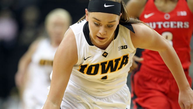 Iowa's Alexa Kastanek steals the ball during the Hawkeyes' game against Rutgers at Carver-Hawkeye Arena on Monday, Jan. 4, 2016.