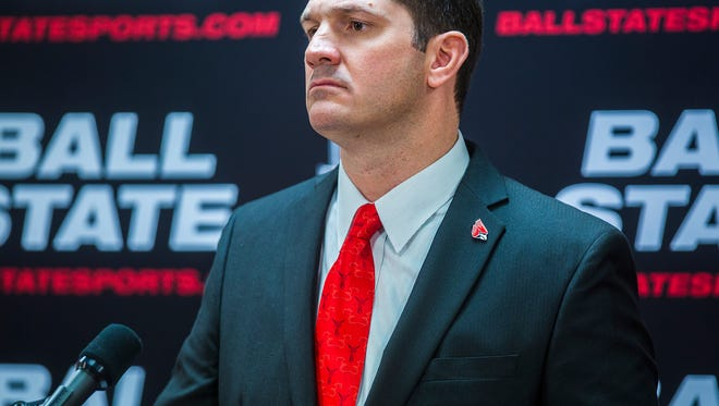 Mike Neu wears a Cardinals pin during his press conference at Worthen Arena Friday afternoon.