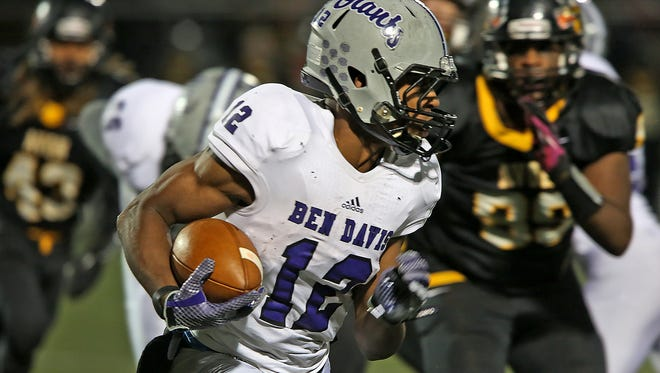 Ben Davis RB Chris Evans was caught in the middle of one of college football's top rivalries.