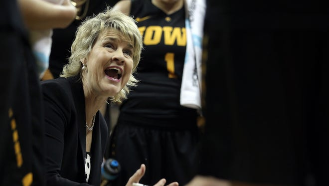Iowa head coach Lisa Bluder talks to her team during the Hawkeyes' game against Drake at Carver-Hawkeye Arena on Tuesday, Dec. 22, 2015.