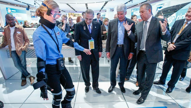 Michigan Governor RIck Snyder watches a demonstration of Imparirment Simulator Suit at the Ford Exhibit Ford Executive Joseph Hinrichs, right, during the 2016 North American International Auto Show held at Cobo Center in downtown Detroit on Tuesday, Jan. 12, 2016. Kimberly P. Mitchell/Detroit Free Press