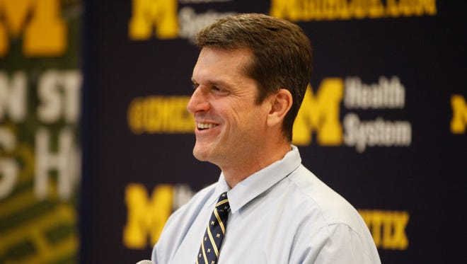 Michigan head football coach Jim Harbaugh during a press conference on his first recruiting class at Schembechler Hall  on Wednesday, February 4, 2015 in Ann Arbor.