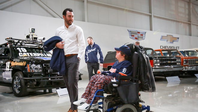 Detroit Tigers' Justin Verlander talks with Gabriel Mio, 17, of Highland Twp during a private tour of GM Heritage Center in Sterling Heights, Mich., during their winter caravan on Friday, Jan. 22, 2016. Mio came on the tour through Make-A-Wish foundation.