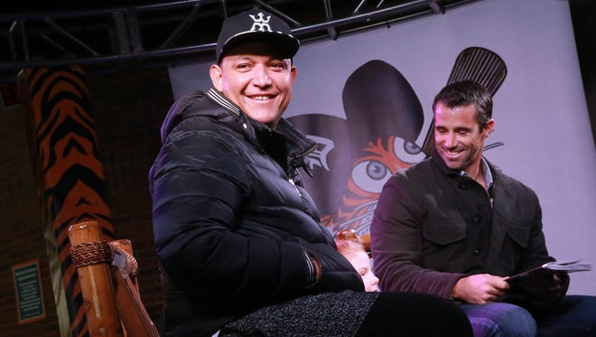 """Detroit Tigers Miguel Cabrera and Brad Ausmus read """"Mighty Miggy"""" in the Kids Zone during the Detroit Tigers' TigerFest at Comerica Park in Detroit on Saturday, Jan. 23, 2016."""