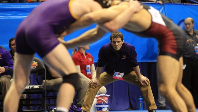 UNI head coach Doug Schwab watches Cooper Moore wrestle Stanford's Jim Wilson at 165 pounds in the NCAA Championships consolations at the Scottrade Center in St. Louis, Mo. on Friday, March 20, 2015. Wilson won in sudden victory, 7-5.  David Scrivner / Iowa City Press-Citizen