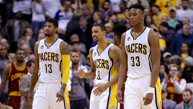 Dejected Indiana Pacers forward Paul George (13),  George Hill (3) and Myles Turner,right, walk off the court late  in the second half of their game Monday, Feb 1, 2016, evening at Bankers Life Fieldhouse. The Indiana Pacers lost to the Cleveland Cavaliers 106-111.