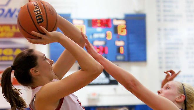 Naomi McDaniel of Attica shoots a jumper in the sectional game with Riverton Parke.