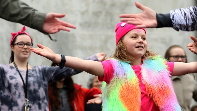 Chantz Miller, 10, of Salem, dances during a One Billion Rising rally at the Oregon State Capitol in Salem on Sunday, Feb. 14, 2016. The event is part of a worldwide campaign to end violence against women and girls.