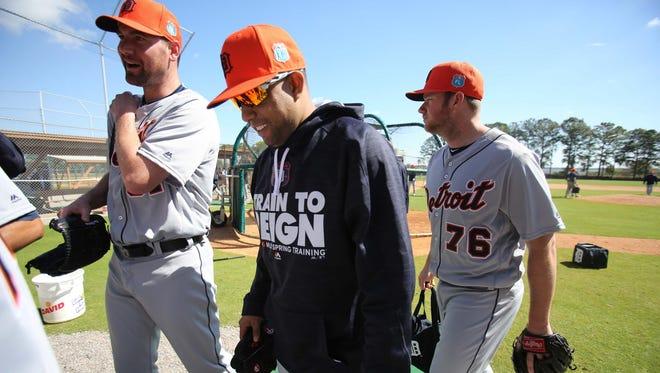 From left, Mike Pelfrey, Francisco Rodriguez and Preston Guilmet walk off the practice field Thursday at Joker Marchant Stadium in Lakeland, Fla.