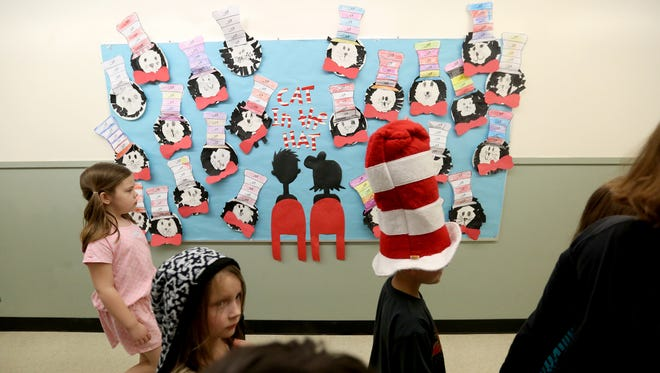 Students move between classrooms during Read Across America Day in honor of Dr. Seuss' birthday at Brush College Elementary School in West Salem on Wednesday, March 2, 2016.