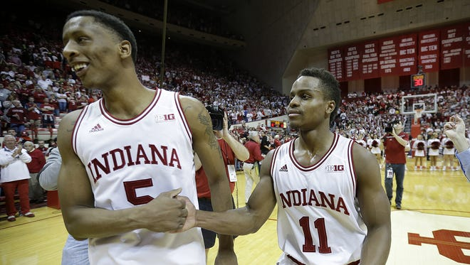 Indiana Hoosiers guard Yogi Ferrell (11) celebrates with Troy Williams (5) following their B1G men's basketball game Sunday, Mar 6, 2016, afternoon at Assembly Hall in Bloomington. The Indiana Hoosiers defeated the Maryland Terrapins 80-62.