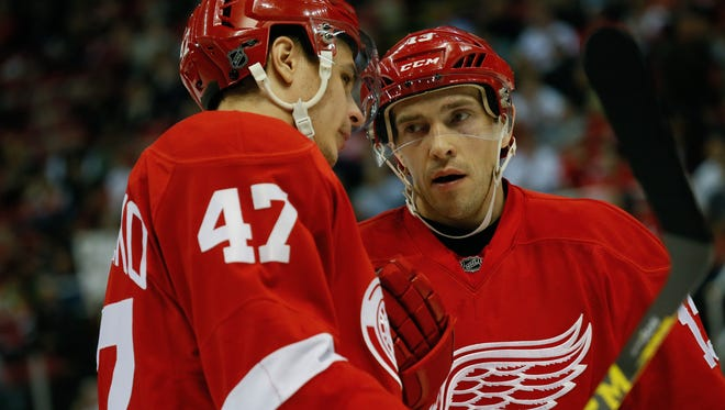 Red Wings forward Pavel Datsyuk talks with defenseman Alexey Marchenko during a time-out during the Wings' 3-2 win Monday at Joe Louis Arena.