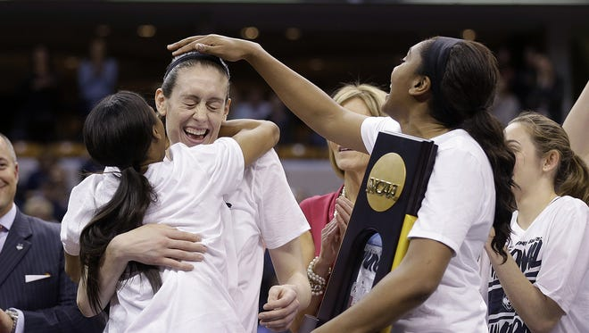 Connecticut Huskies  Moriah Jefferson (4) hugs Breanna Stewart (30)  as Morgan Tuck (3),right, pats her on the head after winning the the NCAA women's college basketball championship game at Bankers Life Fieldhouse on April 5, 2016. The Connecticut Huskies/ defeated the Syracuse Orange 82-51.