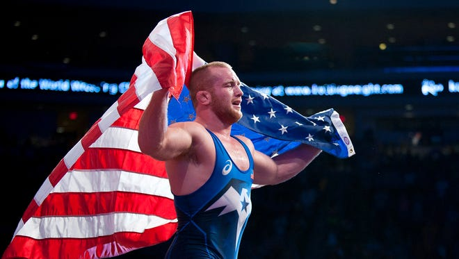 Kyle Frederick Snyder of the United States makes a victory lap after winning a gold medal match against Abdusalam Gadisov of Russia during the fifth night of the World Wrestling Championships at The Orleans Arena.