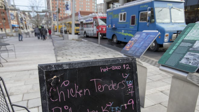The food truck scene during milder than usual temperatures on Georgia Street, downtown Indianapolis, Saturday, Jan. 17, 2015.