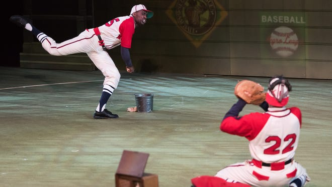 """Satchel Paige (Robert Karma Robinson) throws a pitch to Buck O'Neil (Michael Chenevert) in """"Satchel Paige and the Kansas City Swing,"""" which will be performed on the Cincinnati Playhouse in the Park's Marx Theatre stage from April 23 through May 21. Photo by Jon Gitchoff."""