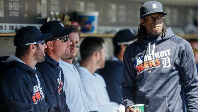 Detroit Tigers' Cameron Maybin, right, who did not play in the game, talks with pitchers Justin Verlander and Mike Pelfrey during a game against the Cleveland Indians at Comerica Park in Detroit on Sunday, April 24, 2016.
