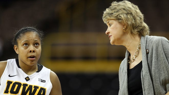 Iowa women's basketball coach Lisa Bluder thinks point guard Tania Davis (left) can take a big leap forward as a sophomore if she becomes more vocal and more accurate from 3-point range.