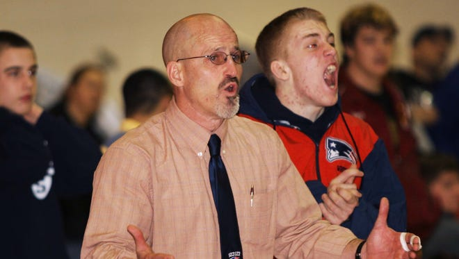 Coach Tom Cook pleads Seeger's case at the Lafayette Jeffwrestling sectional in 2007.