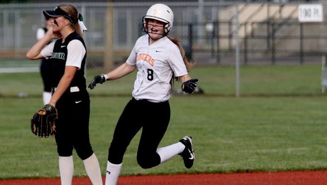 Scio's Kelsey Pollard (8) smiles while rounding the bases for her home run in the Rainier vs. Scio softball game, in the semifinals of the OSAA Class 3A state playoffs, at Scio High School on Tuesday, May 31, 2016. Rainier won the game 6-4.
