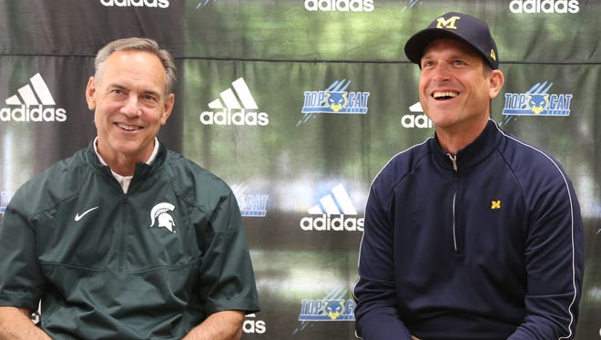 Michigan State football coach Mark Dantonio, left, and Michigan coach Jim Harbaugh talk to reporters during the Sound Mind Sound Body camp at Wayne State on June 10, 2016.