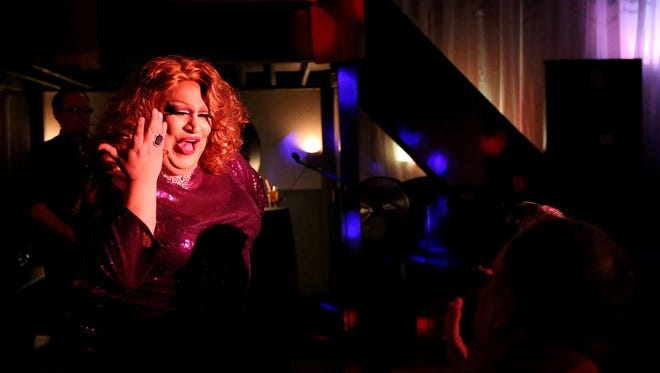RiRi CalientŽé performs in a drag show at the Southside Speakeasy in January. The Mid-Valley's LGBTQ organizations are sponsoring a fundraiser for the victims of the Orlando shooting massacre. The event includes a drag show, silent auction and raffle June 26 at the Speakeasy.