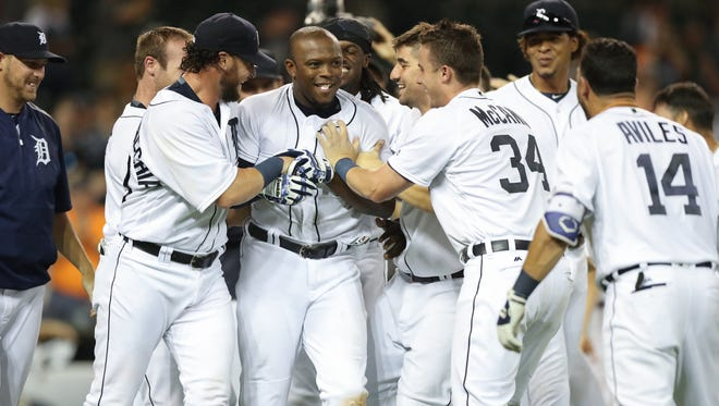 Detroit Tigers leftfielder Justin Upton, center, celebrates with teammates after his walk-off homer against the Seattle Mariners' Vidal Nuno in the 12th inning Monday, June 20, 2016 at Comerica Park in Detroit, MI.