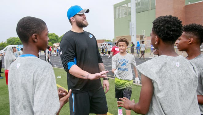 Detroit Lions's first round draft pick Taylor Decker talks with kids during a break at the Heads Up Football Clinic at Detroit Renaissance High School on Thursday, June 23, 2016.