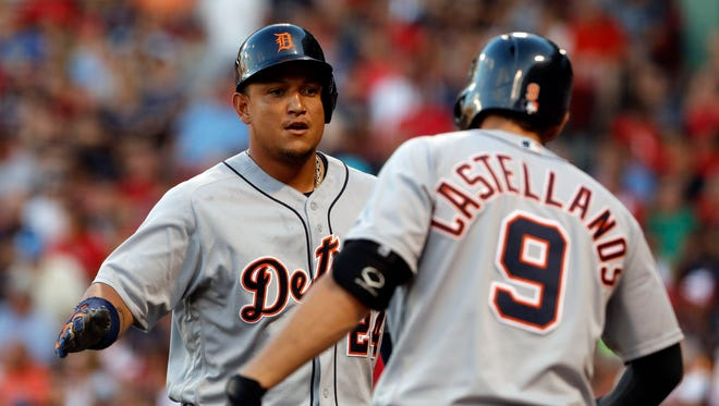 Tigers first baseman Miguel Cabrera (24) is congratulated by third baseman Nick Castellanos (9) after a two-run homer Tuesday in Boston.