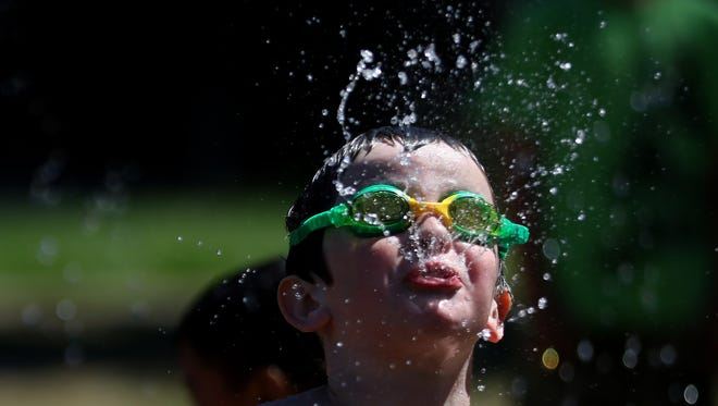 Enoch Lounsbury, 7, of Turner, plays at the splash pad at Wes Bennett Park in Salem on Tuesday, July 26, 2016. Temperatures reached 86 degrees on Tuesday and are expected to exceed 90 degrees for the next three days.