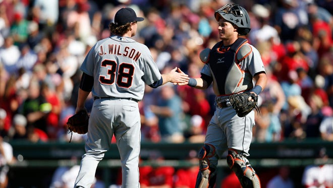 Jul 27, 2016; Boston, MA, USA; Detroit Tigers pitcher Justin Wilson (38) and catcher James McCann (34) celebrate defeating the Boston Red Sox 4-3 at Fenway Park.