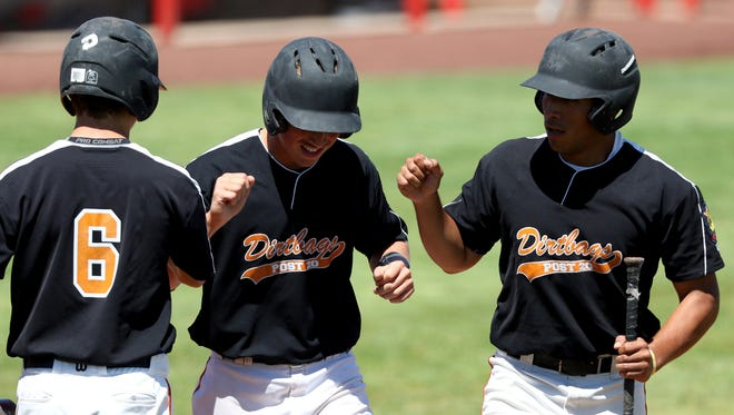 Dirtbags players celebrate in the Demarini Dirtbags vs Gresham Advanced Metals baseball game in the Class AAA American Legion state tournament at Volcanoes Stadium in Keizer on Friday, July 29, 2016. The Dirtbags won the game 17-6.
