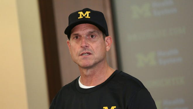 Michigan football coach Jim Harbaugh speaks to reporters during U-M media day Sunday, August 7, 2016, at Michigan Stadium in Ann Arbor.
