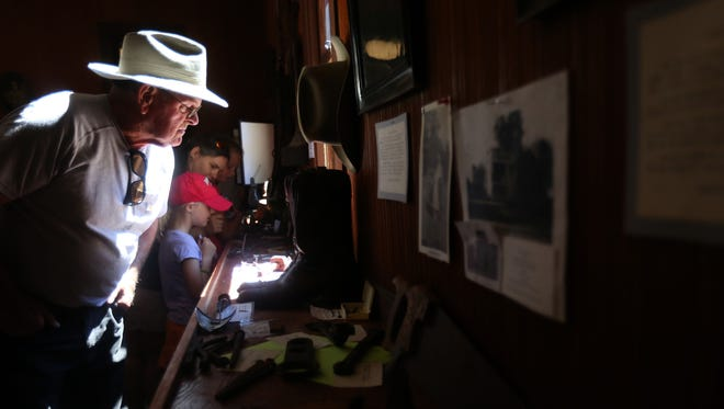Pete Holt, 76, of Mt. Angel, looks through items on display in the Scotts Mills Historical Museum during a celebration for the centennial of Scotts Mills, Ore., on Sunday, Aug. 14, 2016.