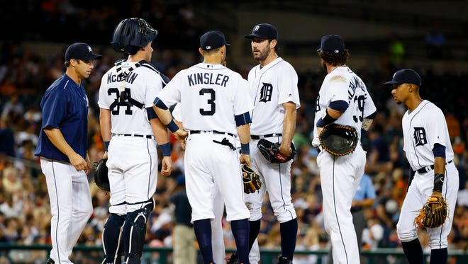 Aug 16, 2016; Detroit, MI, USA;  Detroit Tigers manager Brad Ausmus (left) relieves starting pitcher Justin Verlander (center) in the eighth inning against the Kansas City Royals at Comerica Park.